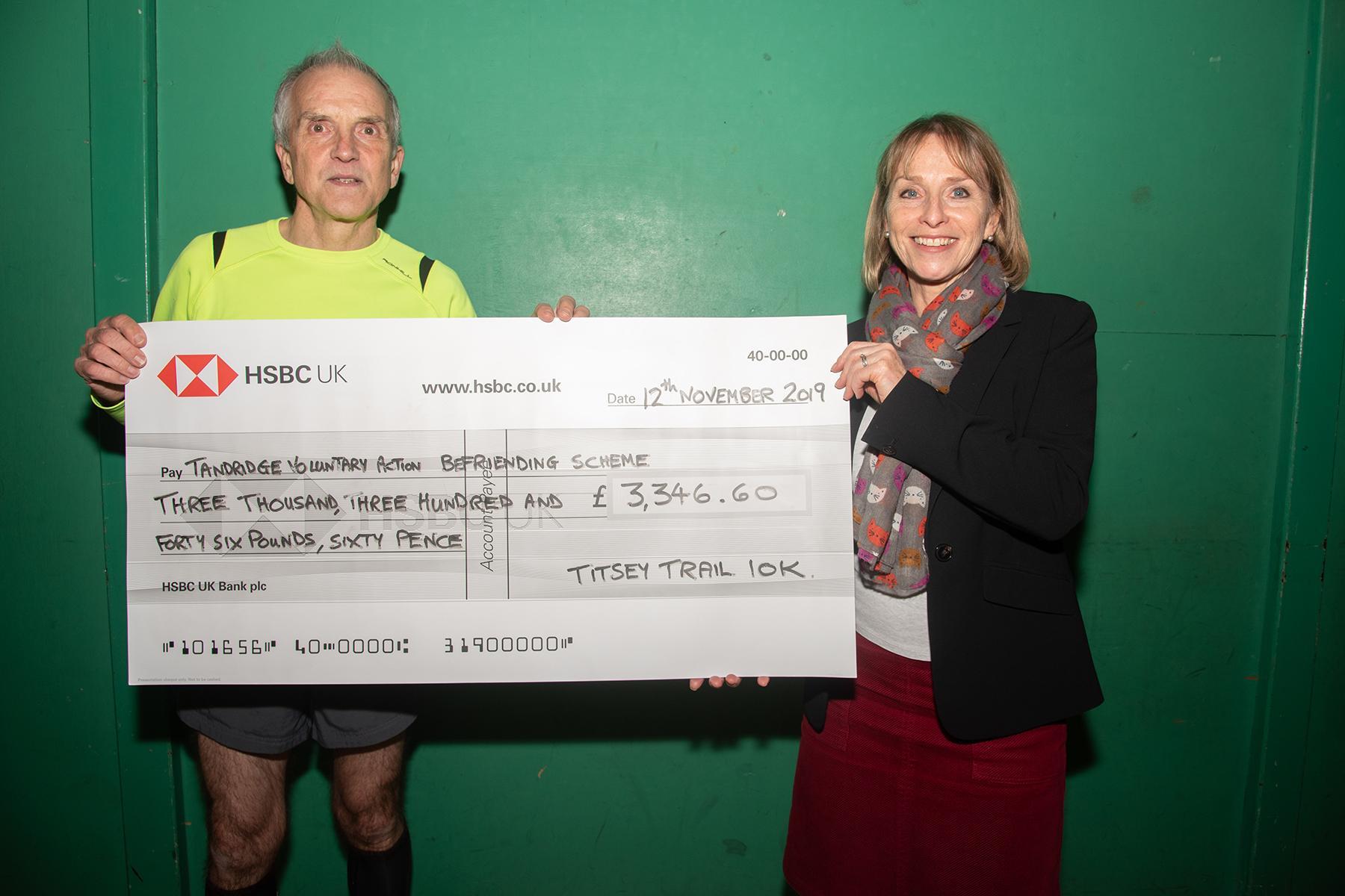 Tandridge Befriending Scheme receive a Donation from Oxted Runners